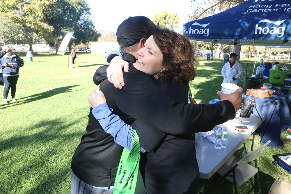 Mindy Mordecai hugging a supporter of ECAN